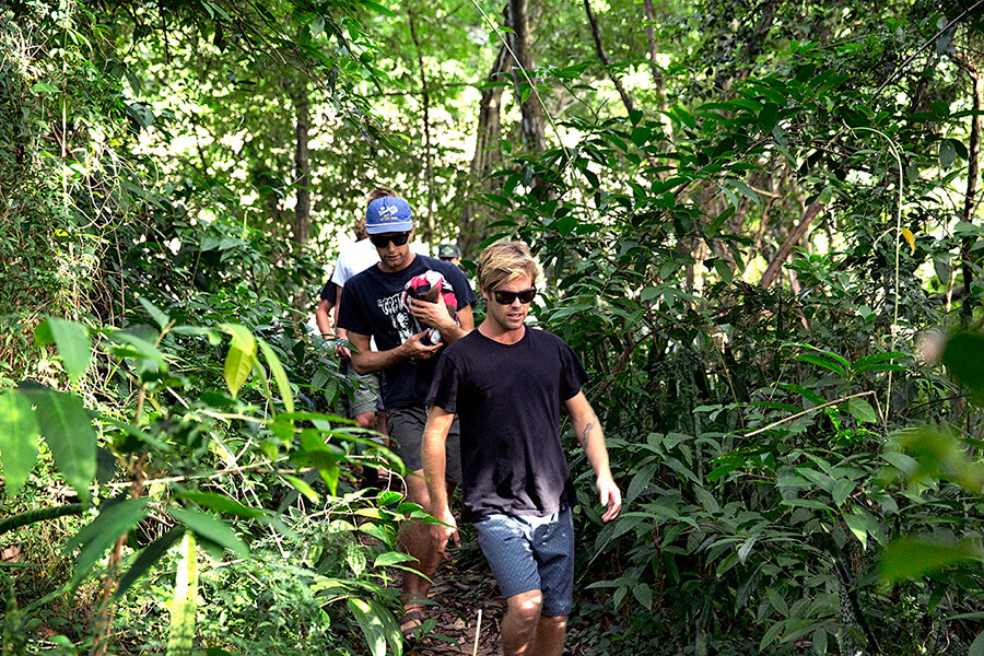 Dylan and the boys marking through the hawaiian jungle.